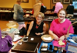 Roxanne and Mary Working the Checkout at our Nov 2016 Pawbrokers Party